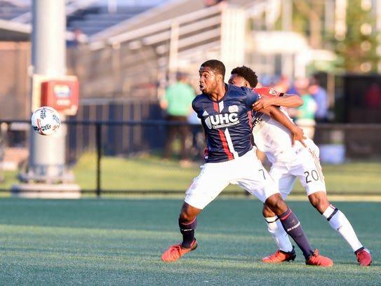 New England Revolution forward Brian Wright (7) and