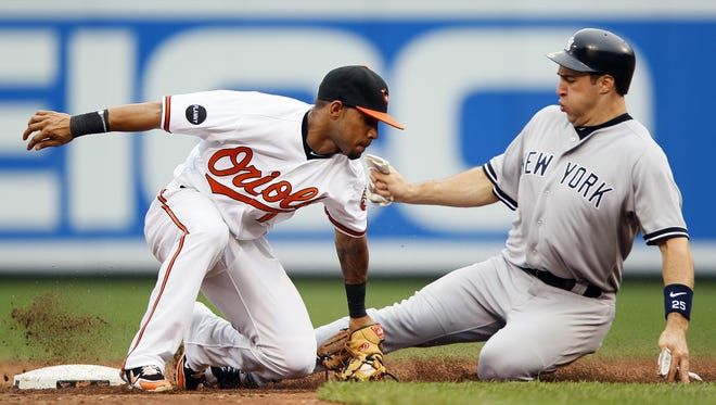 Former Somerset Patriots player Robert Andino has started with the Miami Marlins, but his two most notable seasons in the majors so far came in 2011 and 2012 with the Baltimore Orioles. Here, he tries to tag out the Yankees' Mark Teixeira in 2011.