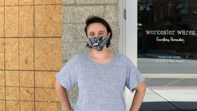 Jessica Walsh stands outside her store at the DCU Center, Worcester Wares, after it was burglarized Monday morning.