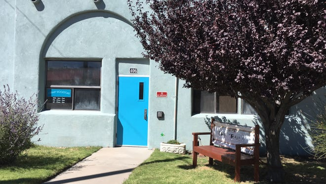 A blue door marks the entrance to the Book Lovers Used Bookstore in Carrizozo.