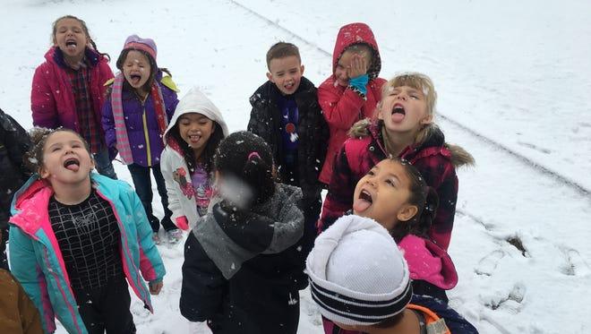 Students in Bonnie Bobrick's class at Yerington Elementary School taste snowflakes falling on Jan. 12.