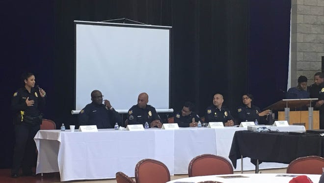 Six Phoenix police officers, including Chief Jeri Williams (far right), answer questions at about how to join the department, during an informational session March 18, 2017, in Phoenix.