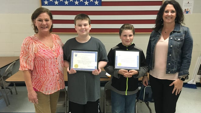 Winners of the 2016~2017 Arkansas State Elks Americanism Essay Contest were recently honored during an awards assembly at Pinkston Middle School. Sixth-grade winners were Sam Anderson, first in state certificate plus a $200 check, and Jayden Henson, third in state certificate plus a $100 check. Their essays were chosen from more than 280 essays locally and then competed state wide. Sam's essay will now go on to compete for national honors. This is the third consecutive year that Pinkston Middle School students have won the state contest. Shown are Jill Ryan, sixth grade literacy teacher, from left, Anderson, Henson, and Vonya Schaufler, sixth grade science teacher and MountainHome Elks Americanism chairman.