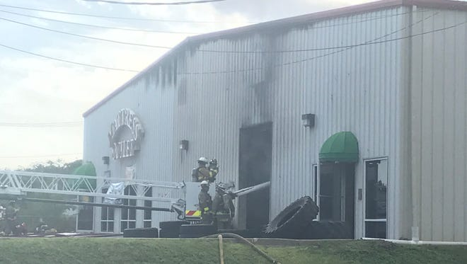 Escambia County fire crews responding on Tuesday, July 25, 2017, to a fire at the Koala Mattress Factory on Fairfield Drive.