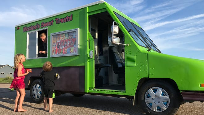 Maxine Kremer stops for customers with her ice cream truck, Maxine's Sweet Treats, Aug. 8, 2017, in Pittsville.