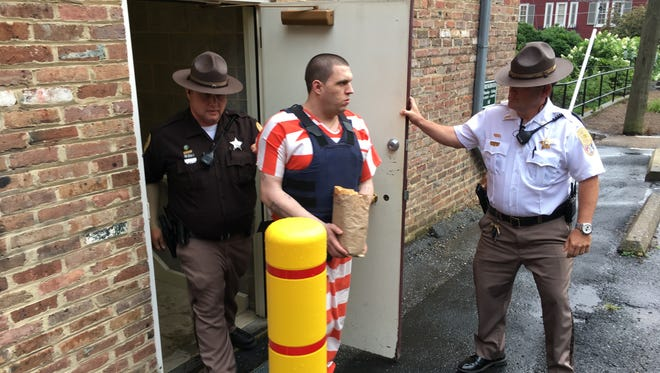 Steven Decker is escorted from the Staunton Courthouse on Tuesday afternoon.