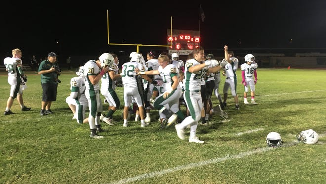 Greenway players celebrate after the team's come-from-behind, 29-26 victory at Peoria on Friday, Oct. 6, 2017.