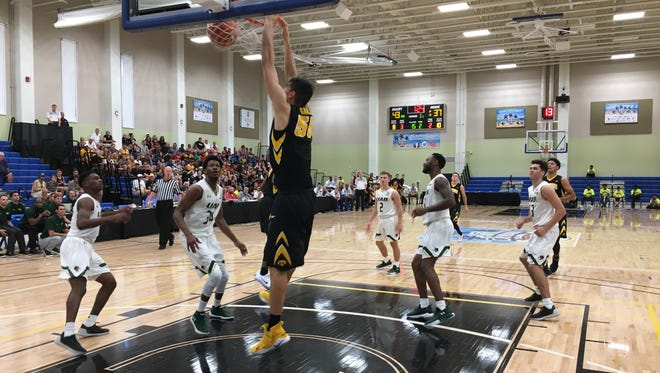 Iowa center Luka Garza goes up for a dunk that punctuated a 27-6 run to end the first half of Wednesday's game against Alabama-Birmingham in the Cayman Islands Classic.