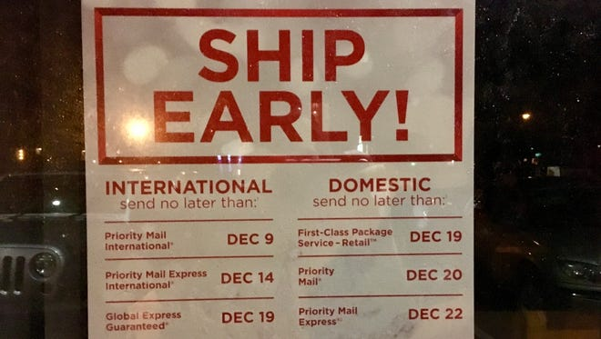 This sign posted at the Jensen Beach Post Office on A1A is a good reminder to ship gifts early.