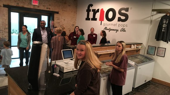 Frios Gourmet Pops employees prepare to serve the first customers Tuesday at the new downtown Montgomery location.