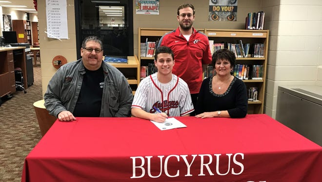 Bucyrus' Gram Dick, alongside his parents and coach, commits to Ohio Wesleyan.