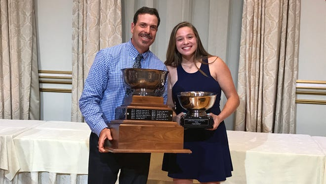Lakeland athletic director John Yost joins senior Sarah Deighan as the soccer-basketball-lacrosse standout accepts the Passaic County Female Student-Athlete of the Year Award at The Tides in North Haledon on Monday, June 11, 2018.