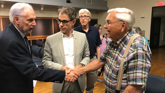 Bridgewater councilmen Howard Norgalis, left, and Filipe Pedroso congratulate Bob Vaucher on helping to preserve a Revolutionary War site at Foothill and Steele Gap roads. The council is expected to approve the $1.9 million purchase of the historic site on Aug. 6. Behind them is Vaucher's neighbor Gene Francis.