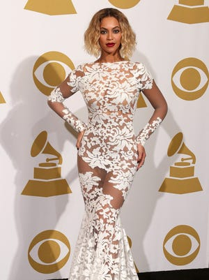 Beyonce poses in the Grammy press room.