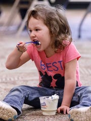 Four-year-old Mya Tann of New Berlin gobbles down her CulverÕs sundae during the summer reading program kickoff party at the Hales Corners Library on Monday, June 11, 2018. The event featured an ice cream social sponsored by the Friends of the Library and CulverÕs of Hales Corners, free face painting, T-shirt decorating and delicious offerings from the Firewise Barbecue Co. food truck.