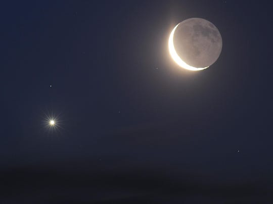 The planet Venus, left, and the crescent moon form a striking pair in the sky.