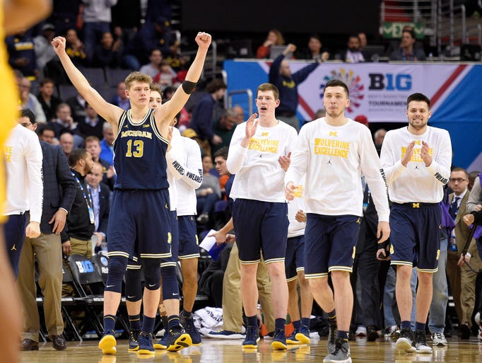 Michigan forward Moritz Wagner (13) and others celebrate