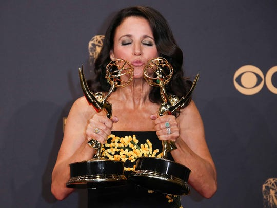 Julia Louis-Dreyfus smooches her awards for outstanding