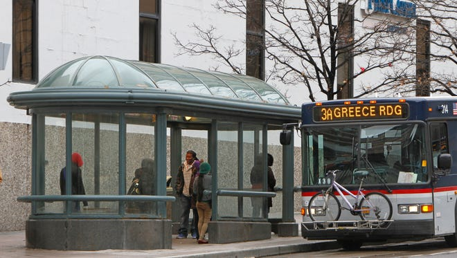 A RTS bus pulls up to the bus shelter on the north side of East Main Street earlier this spring.