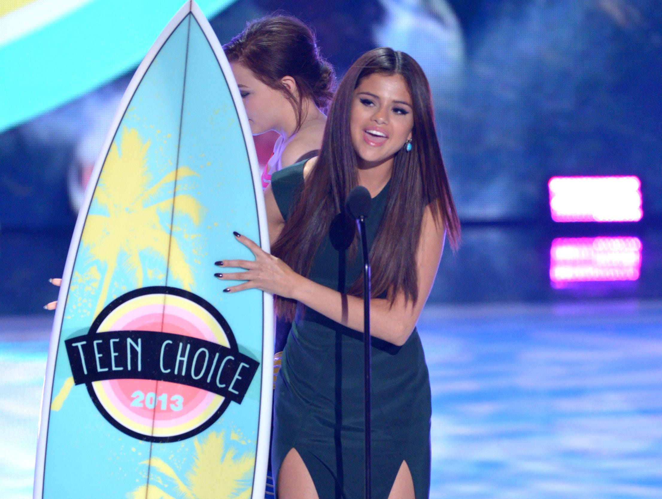 "Actress/singer Selena Gomez accepts the award for Choice Break-Up Song for ""Come and Get It."""