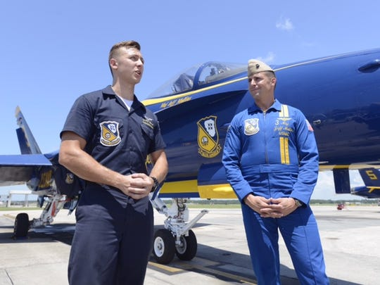 Blue Angels Crew Chief Kyle Wood, left, and U.S. Marine Corps Maj. Jeff Mullins, a Blue Angels pilot, talk Thursday, July 12, 2018, about the team's upcoming air show at Pensacola Beach.