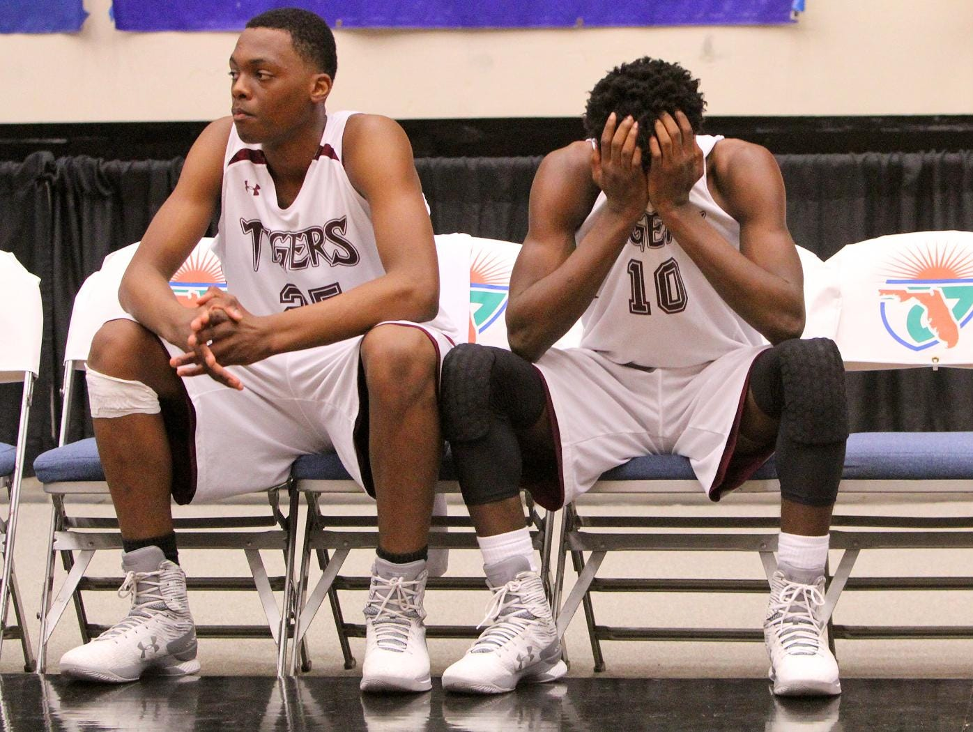 Pensacola Javon Grimsley and Zykereyan Jones on the bench after losing the match to Largo during the FHSAA 6A semi final Friday February 26, 2016 in Lakeland, Florida. Pensacola lost the match 54-56.