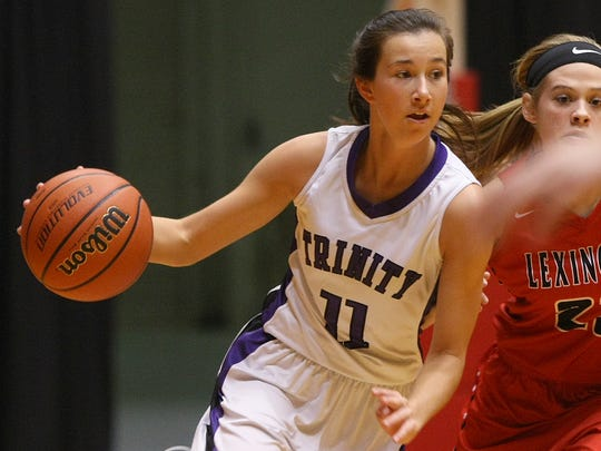 Trinity Christian Academy's Brynne Lytle (11) scored her 2,000th point during the HUB Classic at Oman Arena.