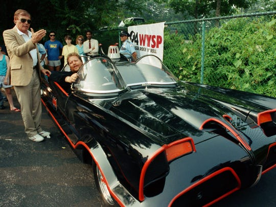 In this June 27, 1989 file photo, Adam West, left, stands beside the old Batmobile driven by owner Scott Chinery in Philadelphia. On Saturday, June 10, 2017, his family said the actor, who portrayed Batman in a 1960s TV series, has died at age 88.