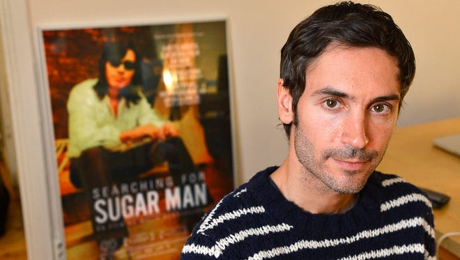 Swedish documentary filmmaker Malik Bendjelloul poses in Dec. 18, 2012. Police in Sweden say the film director behind the Oscar-awarded music documentary 'Searching for Sugarman' died May 13, 2014. He was 36.