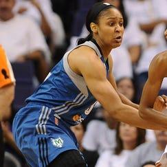 Phoenix Mercury guard DeWanna Bonner (24) handles the ball against the Minnesota Lynx forward Maya Moore (23)