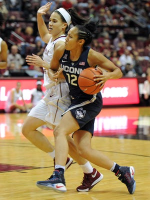 Connecticut Huskies guard Saniya Chong (12) controls the ball against Florida State Seminoles guard Brittany Brown (12) during their game at the Tucker Center (Tallahassee).