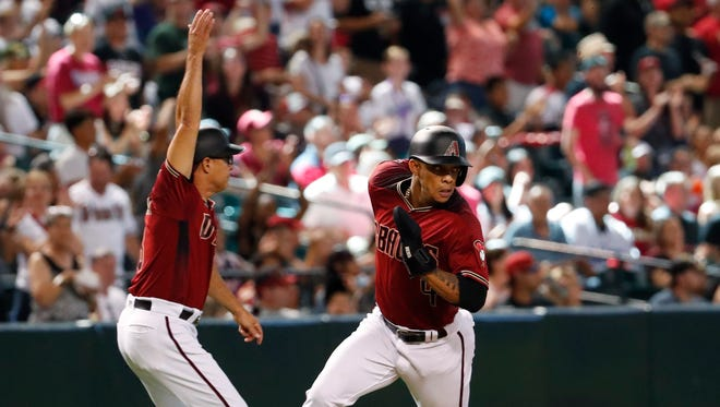 Arizona Diamondbacks shortstop Ketel Marte (4) is waved around third base by third base coach Tony Perezchica against the Miami Marlins during the seventh inning at Chase Field in Phoenix June 3, 2018.