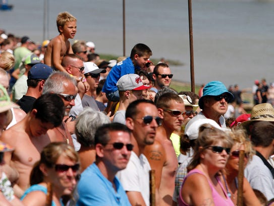 Fans line the river banks during the Madison Regatta