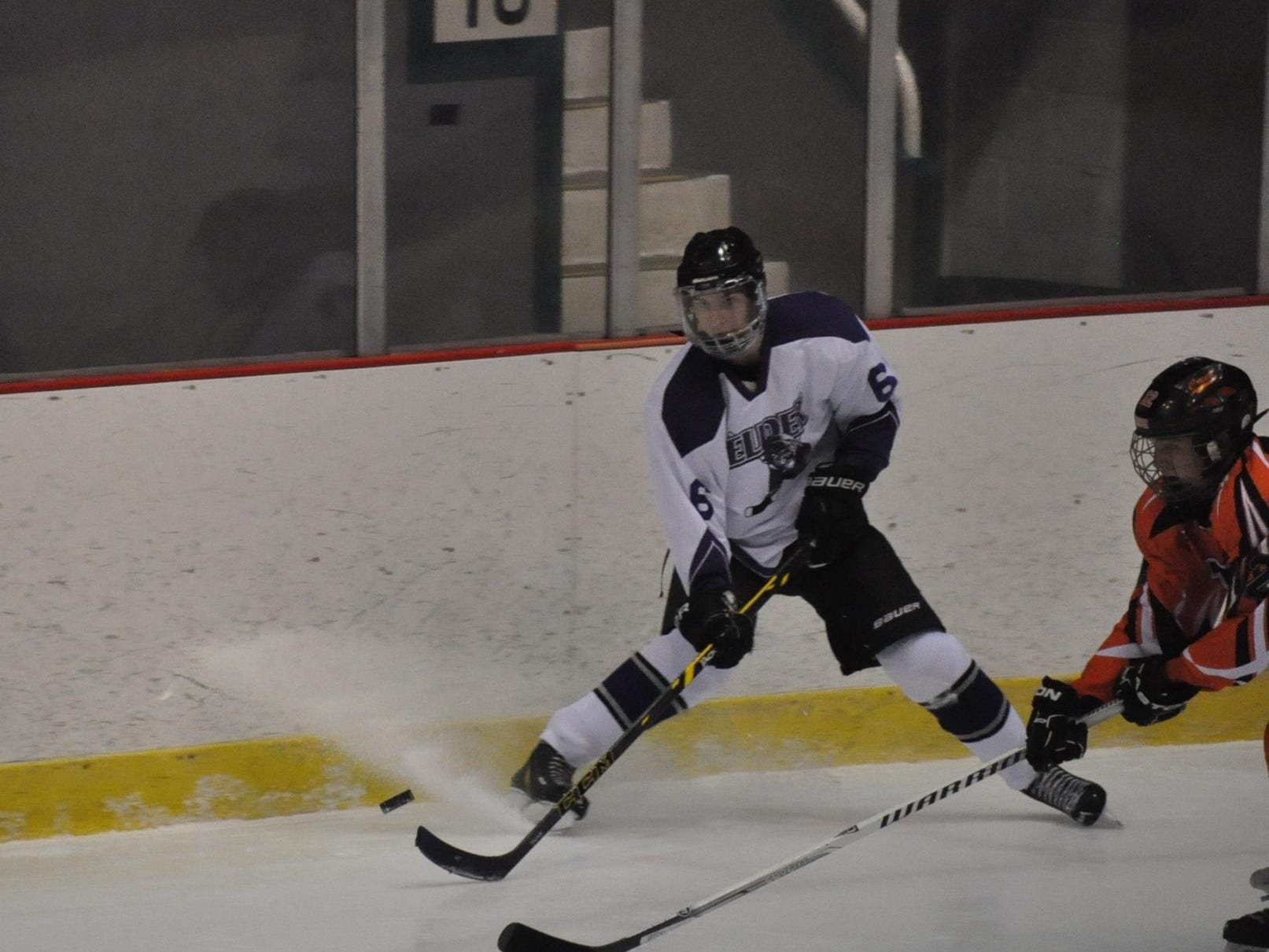 Elder junior Mike Wynn, No. 6, works the puck along the boards in a scrimmage against Beavercreek on Nov. 22 at the Cincinnati Gardens.