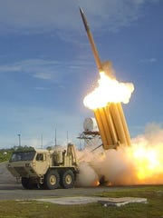 In this file photo, two THAAD interceptors and a Standard-Missile
