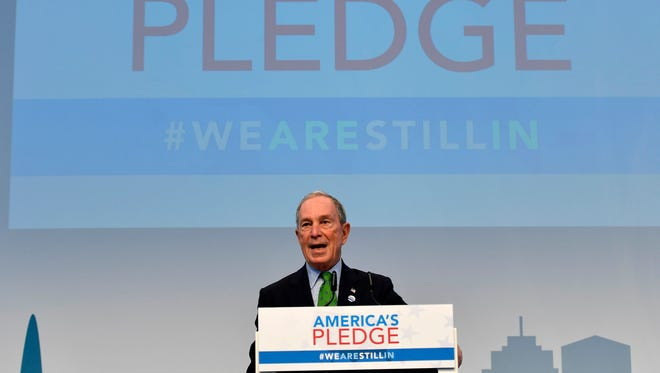 "Former New York Mayor and billionaire Michael Bloomberg speaks in the U.S. Climate Action Center at the COP 23 Fiji UN Climate Change Conference in Bonn, Germany, Saturday, Nov. 11, 2017. The ""America's Pledge"" campaign works to compile and tally the climate actions of states, cities, colleges, businesses, and other local actors across the entire U.S. economy. (AP Photo/Martin Meissner) ORG XMIT: MME108"
