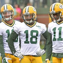 Packers receivers Myles White (19) Randall Cobb (18) and Larry Pinkard (11) during a training camp drill at Ray Nitschke Field.