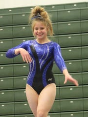 Farmington Unified's Emily Stecevic tied for second on the balance beam with an 8.95 Thursday night.