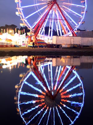 Visitors to the Lee Civic Center attend the Southwest Florida and Lee County Fair despite stormy weather on Thursday night.
