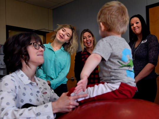 Rion Paige, center in turquoise, reacts with her mother Alisa during a 2018 visit to the West Texas Rehabilitation Center. Paige returns Saturday to sing at Rehab 2019.