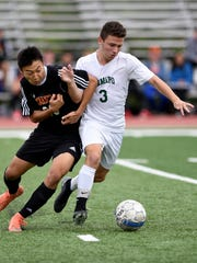 Tenafly's Eita Nakagawa #23 and Ramapo's Dylan Zane #3, play physical while struggling for possession of the ball. Ramapo defeated Tenafly 1-0 in the quarterfinals of the 2017 B.C.C.A. tournament in Mahwah on Sunday, October 15, 2017.