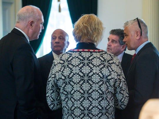 Republican senators confer during a break in discussion
