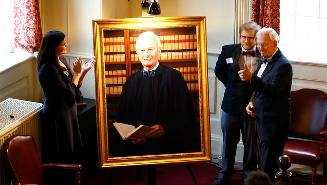 Honorable Supreme Court Justice Stewart Pollock gives the thumbs up to the artist as his portrait is unveiled by his grandchildren Molly Gilson and Jeffrey Pollock in the historic courtroom at the Morris County Courthouse. March 2, 2018. Morristown, NJ.