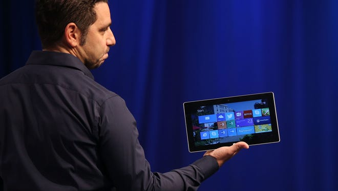 Panos Panay, Microsoft's VP of Surface, introduces with one of the second generation of Surface tablets at an event on Monday.