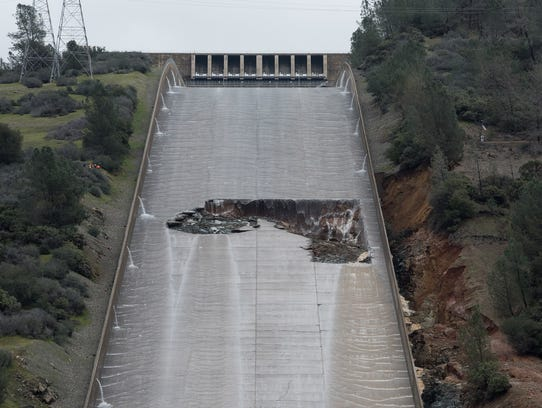 A hole opened on the Oroville Dam spillway Tuesday