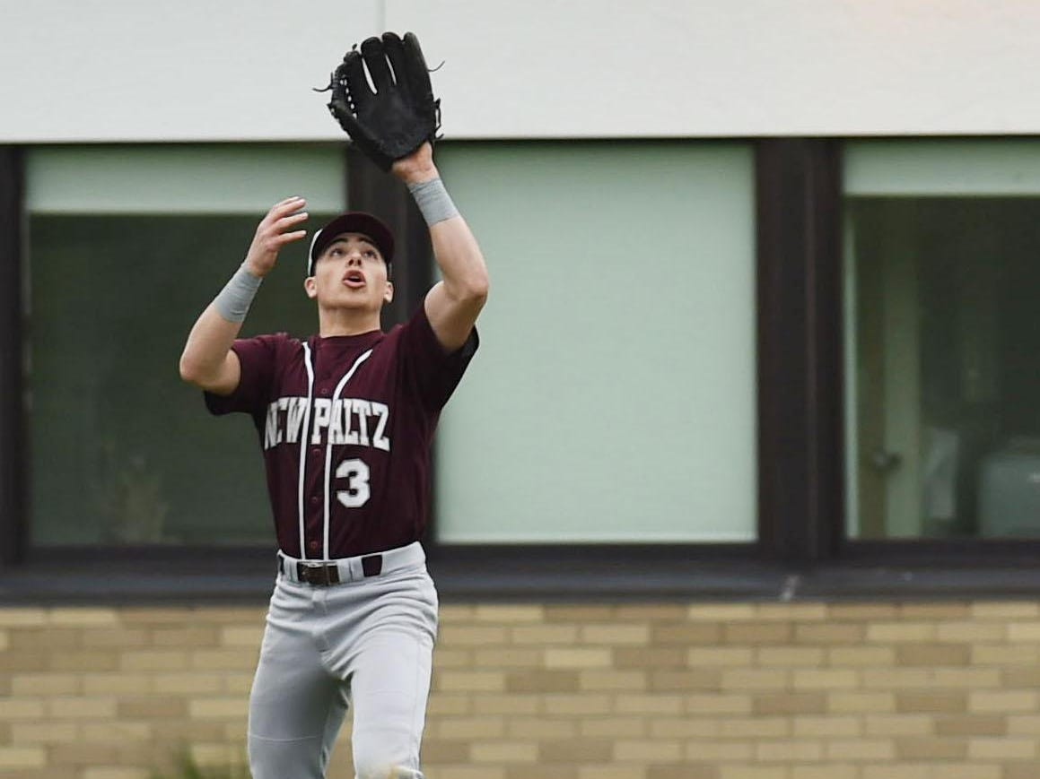 New Paltz's Joe DiMarco catches a fly ball during Monday's game against Highland.