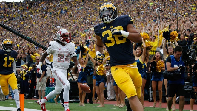 Ty Isaac of the Michigan Wolverines scores a second-quarter touchdown against the UNLV Rebels on Sept. 19, 2015, at Michigan Stadium in Ann Arbor.