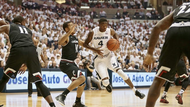 Xavier Musketeers guard Edmond Sumner (4) drives to the basket in the first half of the 83rd annual Crosstown Shootout NCAA basketball game between the Xavier Musketeers and the Cincinnati Bearcats at the Cintas Center in Cincinnati Saturday, Dec. 12, 2015. At the half, Xavier led 42-26.