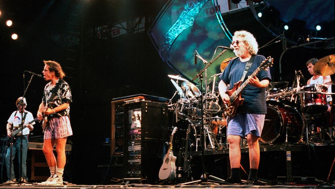 Aug 03, 1994 - East Rutherford, New Jersey, USA - The Grateful Dead in concert on Aug. 3, 1994 in East Rutherford, N.J. From left is Phil Lesh, Bob Wier, Jerry Garcia and Micky Hart.