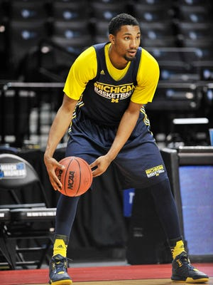 Michigan guard Zak Irvin (21) gets ready for the next drill during Michigan practice.